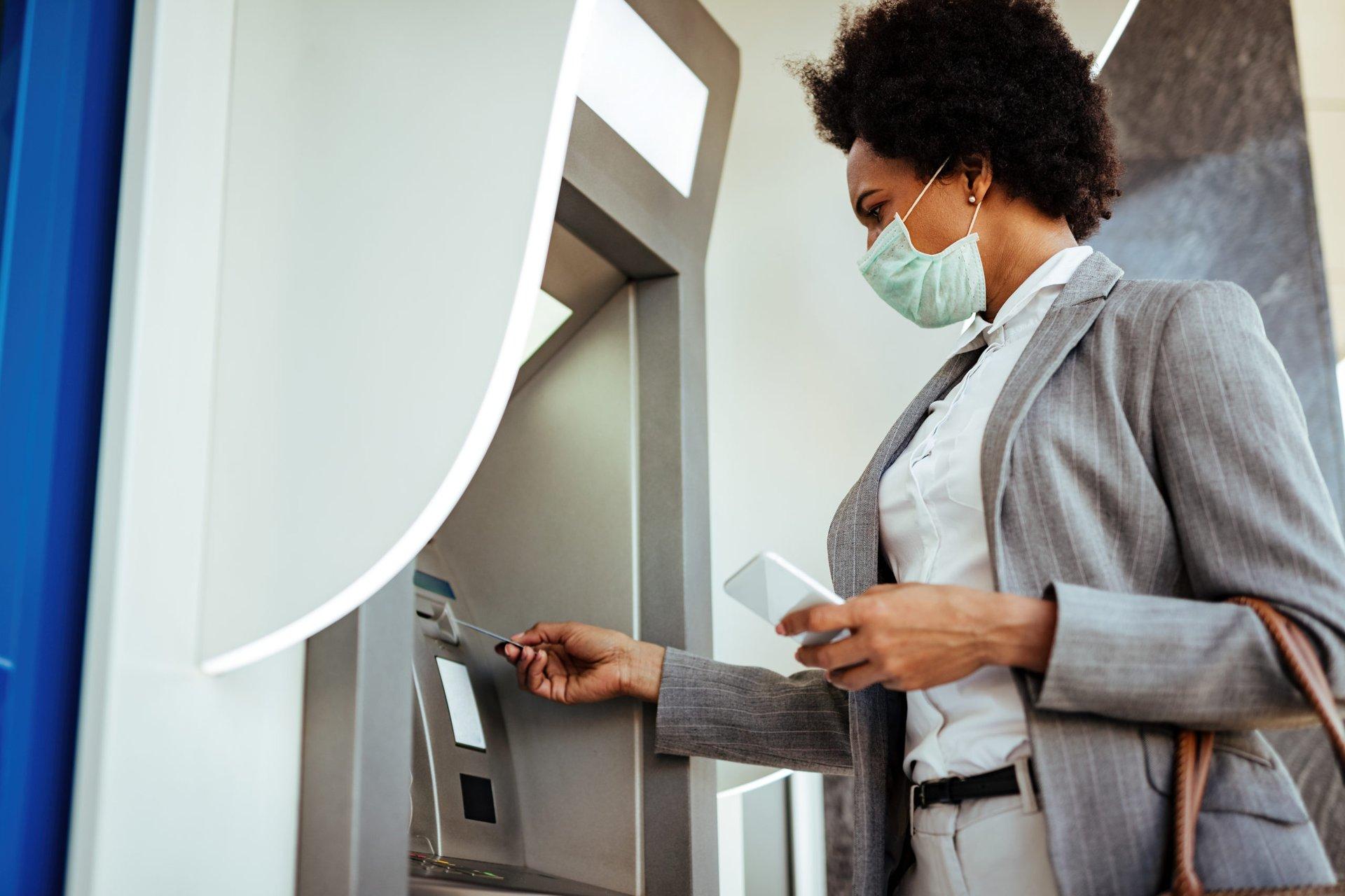 Woman withdrawing stimulus money
