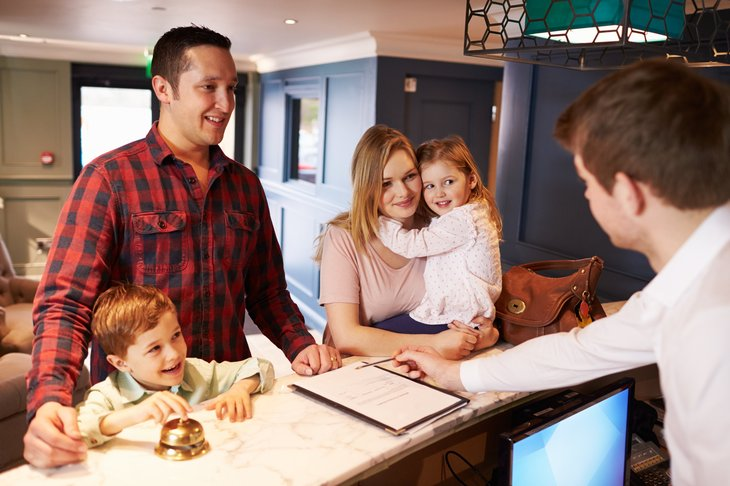 Family checks in at hotel