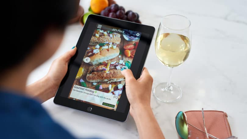 Woman On Tablet Ordering Food Delivery Service