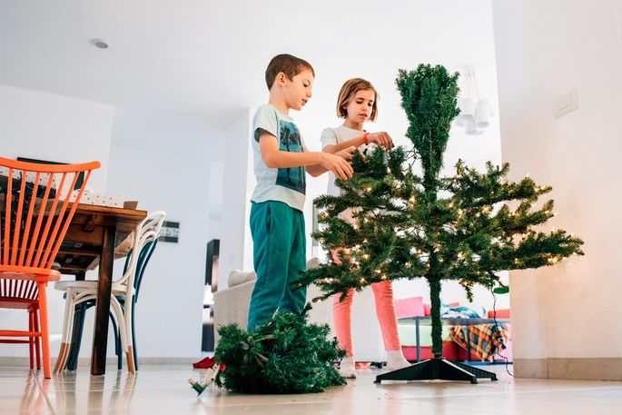 Not all artificial Christmas trees are easy enough for a pair of kids to set up.