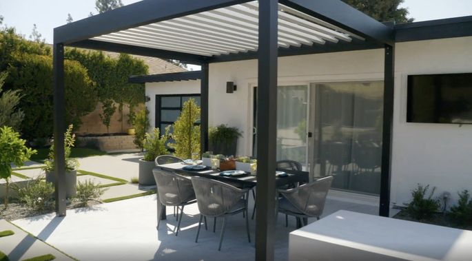 This pergola opens and closes, which is perfect for protection against the sun.