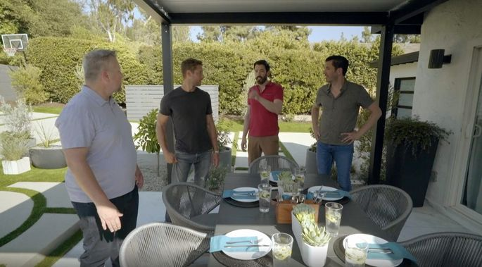 Hartley and the Scott brothers show off the new outdoor dining space.